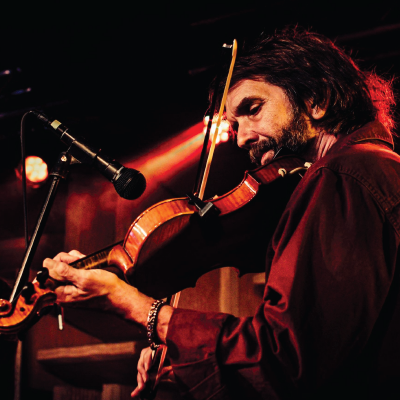 John Gilmore playing fiddle on stage